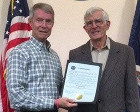 Manassas Mayor Harry Parrish and Dan Peacock with proclamation honoring Dick Peacock